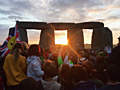 PHOTOS: 12,000 celebrate summer solstice at Stonehenge with glimpse of season's first sunrise