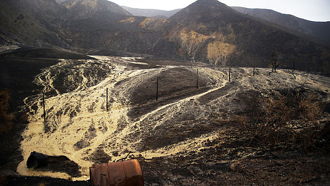 Mud and debris flow down hillsides burned in a recent brush fire after heavy rain from the first in a series of El Nino storms that passed over the area above Solimar Beach in Ventura, Calif., Wednesday, Jan. 6, 2016. (AP Photo/Joel Angel Juárez)